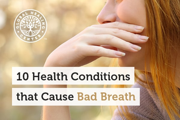 A woman is covering her mouth. Allergies and diabetes can cause bad breath.