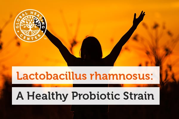 A person is raising their hand. Lactobacillus rhamnosus strain may help with anxiety.