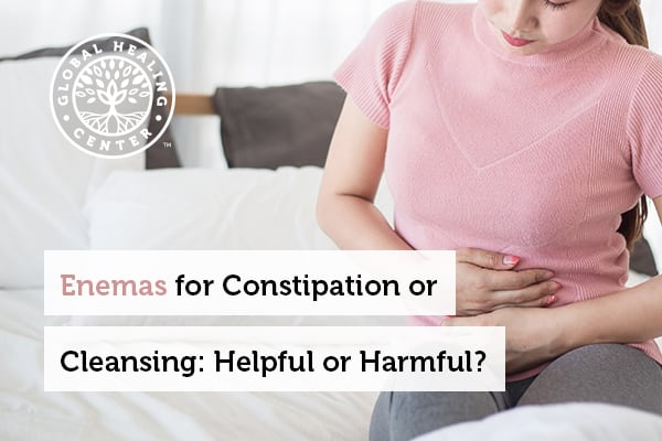 Woman with stomach discomfort from constipation and looking for an enema as a remedy.