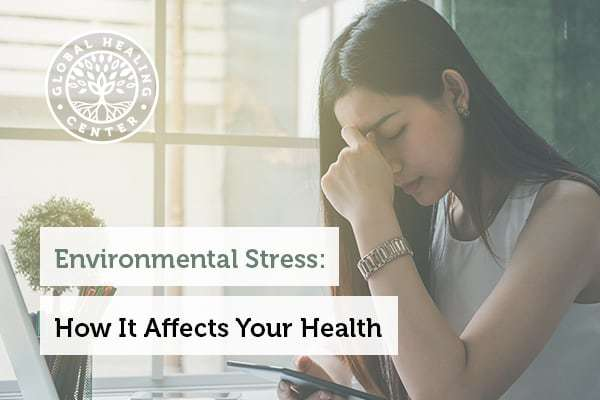 Woman with environmental stressors contemplating how it's affecting her health.