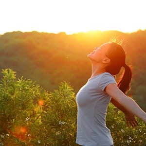 A woman staring at the sun. Lipase helps boost the immune function.