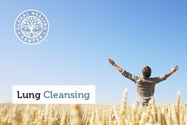 An individual in the middle of a field. Exercising is part of the lung cleansing process.