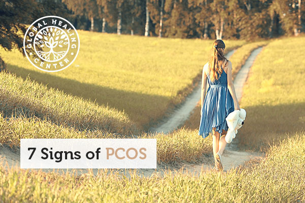 A woman is walking. Increased hair growth and discolored skins are signs of PCOS.