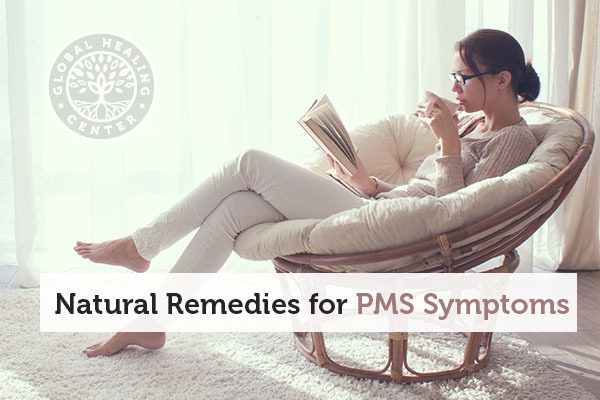 A woman sitting on a chair. Getting plenty of rest is one of many natural remedies for PMS symptoms.