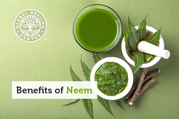 A glass of neem tea. Neem comes in many forms, from oil to tea to honey.