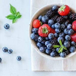 A bowl of fruits. Having a healthy diet can lower your blood sugar.
