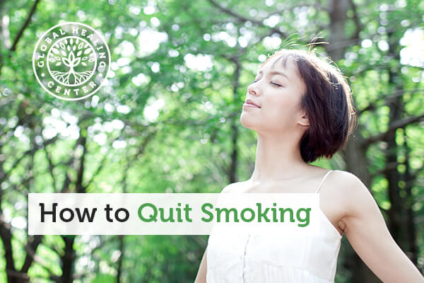 A woman practicing deep breathing outside. Deep breathing can fight cravings when trying to quit smoking.