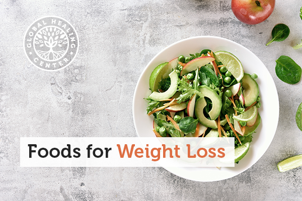 A bowl of salad that contains several weight-loss foods like carrots and avocados.