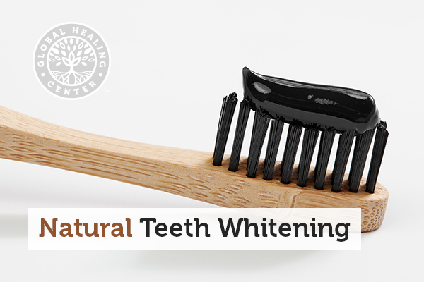 Activated charcoal toothpaste on bamboo toothbrush. Activated charcoal is one of several home remedies for natural teeth whitening.