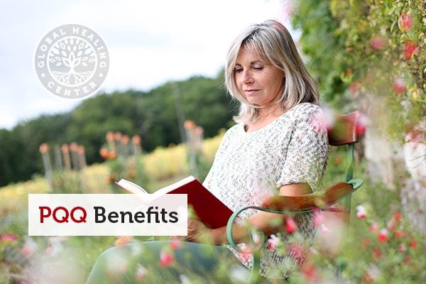 PQQ Benefits. A mature woman reading a book on a chair.