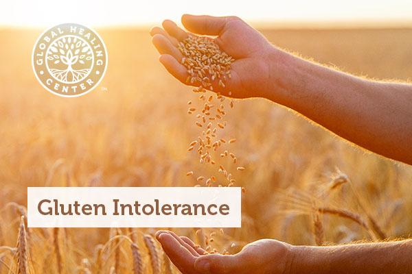 A man holding wheat grains.