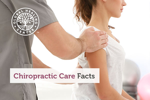 A chiropractor performing back adjustments on his patient.