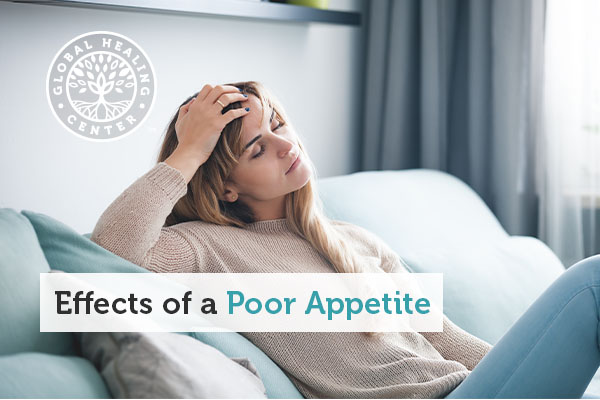 A woman feeling lethargic after eating poor quality food.