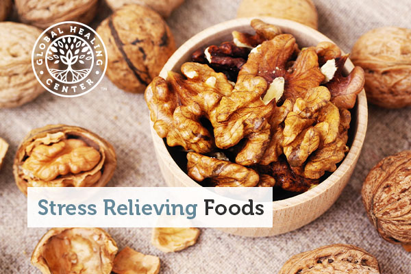 A bowl of walnuts, which are natural stress relieving foods.