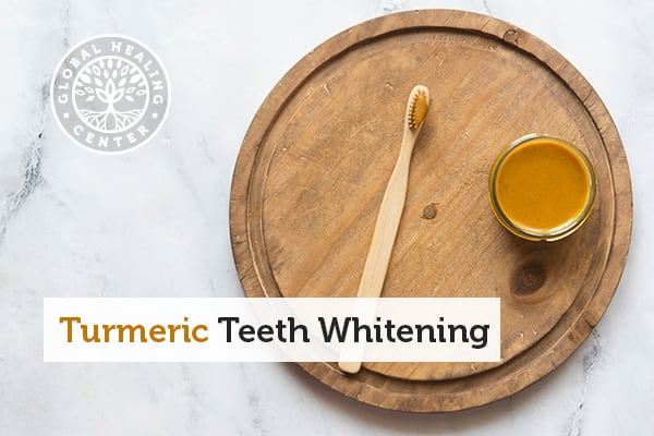 A plate that includes a toothbrush and container of turmeric teeth whitening paste.
