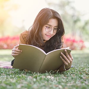 A woman studying in the park.