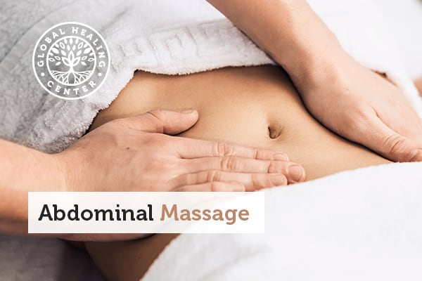A woman getting an abdominal massage.