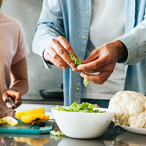 A man preparing fresh vegetables.