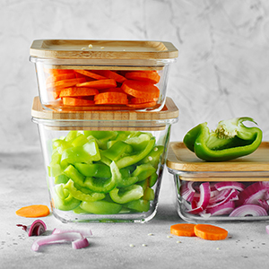 Vegetables in glass containers.
