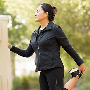 Woman stretching for a run in a natural background.