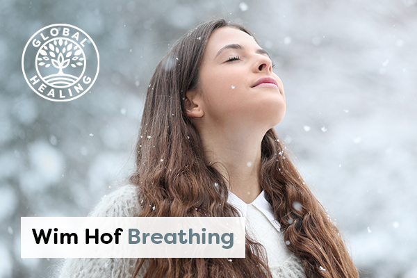 A woman taking a deep breath in a cold environment surrounded by falling snowflakes.